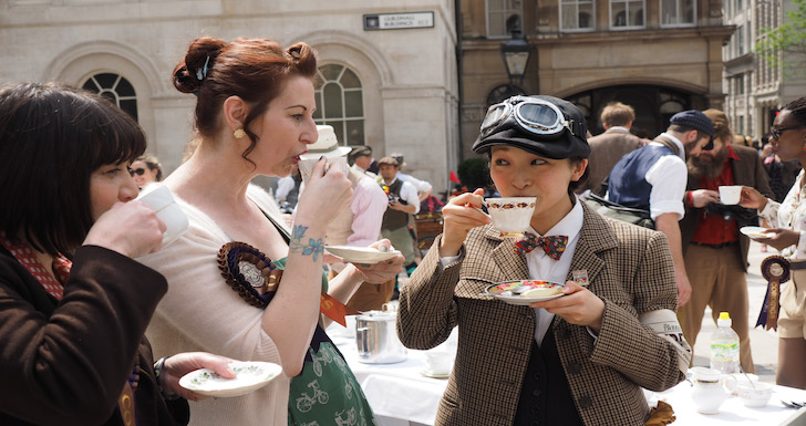 Cyclists sipping Afternoon Tea on London's Tweed Run