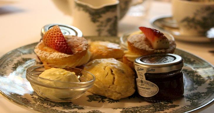 Scones, clotted cream and jam on plate